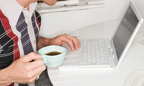Young man with laptop and coffee